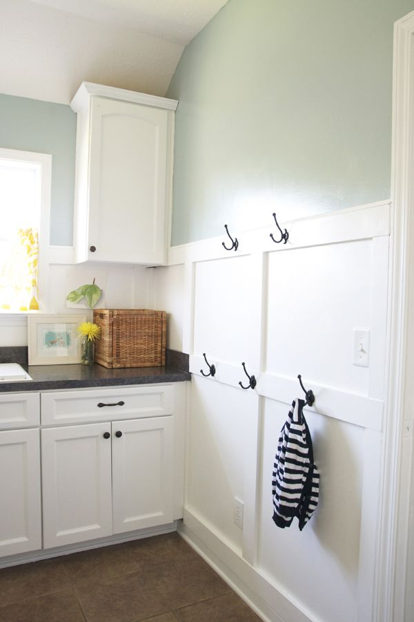 laundry room. love the board and batten installed above the baseboard (DIY). like the hooks as well.