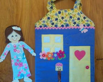 These gorgeous fabric paper dolls are sure to be a little girls best friend! They have a Velcro tummy for easy outfit changes and this set comes with a gorgeous little cottage to keep your doll cozy in bed and all her outfits in her draws.  This set comes with: 1x Single Carry Cottage (includes sewn in bed & wardrobe) 1x cottage doll - you get to choose what skin colour your doll comes with, brown or white) 10x pieces of randomly coloured items of clothing to dress your doll in 2x pairs o...