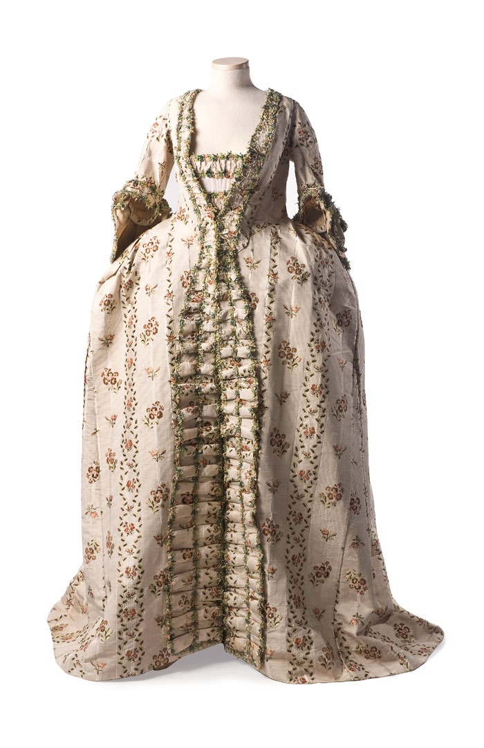 "Robe à la Française: c. 1770, with elaborate fly fringe ornamentation and matching petticoat, it was worn over side hoop panniers for a fashionable silhouette. ""This dress was worn by a member of the family of Henry Middleton, President of the Continental Congress."""