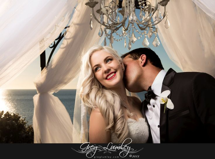 Contemporary 50s inspired moment as groom kisses bride at the Twelve Apostles Hotel Cape Town.  Wedding moments.  Emotion.
