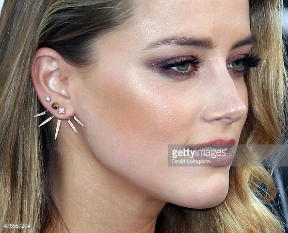 478557204-actress-amber-heard-earring-detail-attends ...