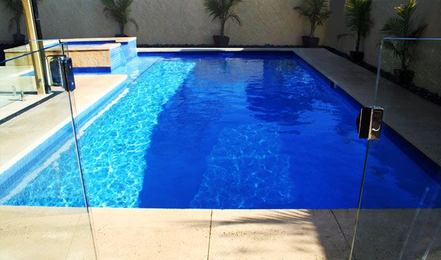 Awesome Modern Style Concrete Swimming Pool Melbourne Design Finished With Glass Pool Fencing Unit Finished With Grey Deck