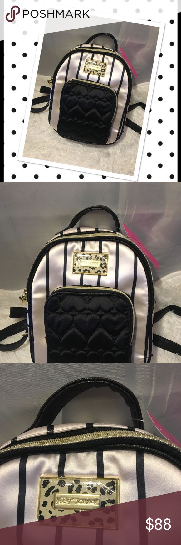 Betsey Johnson mini black white striped backpack Beautiful black & white striped Betsey Johnson Backpack. 100% polyester and lining. Comes from a smoke-free home. Please see my other items - bundle and save! Betsey Johnson Bags Backpacks