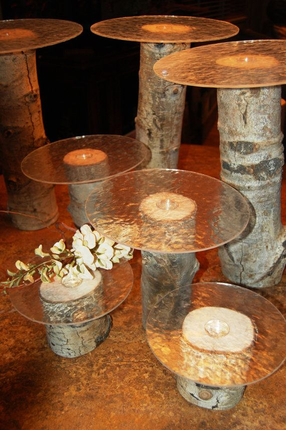 Good Idea for desert table, but too rustic.  I like the varying levels, and the glass.