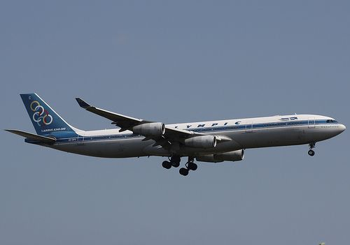 """Olympic Airlines Airbus A340-313 SX-DFC """"Marathon"""" on final approach to New York-JFK, September 2009. (Photo via Flickr: Wendy Bonilla)"""