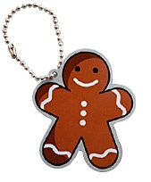 """Dottie the Gingerbread Man Travel Tag  $5.50 USD    Dottie the Gingerbread Man ~ She certainly knows the muffin man who lives down drury lane. Now move her along before she is eaten!    This tag is trackable on http://www.geocaching.com/track/ with a unique icon.    Size: 2"""" (5cm) x 1.75"""" (4.5cm) Gingerbread Man/Woman Shaped!"""