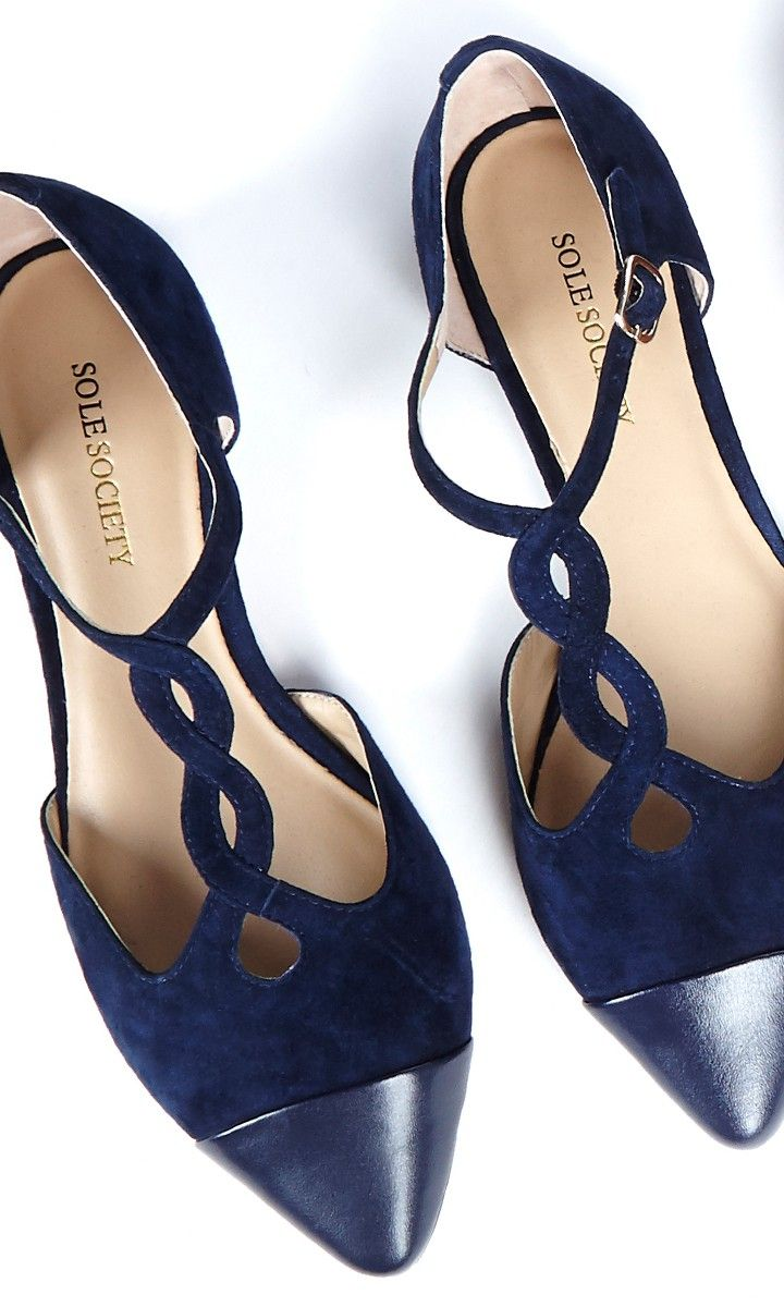 Suede flats with braided T-straps, color blocked toe cap and adjustable ankle strap.