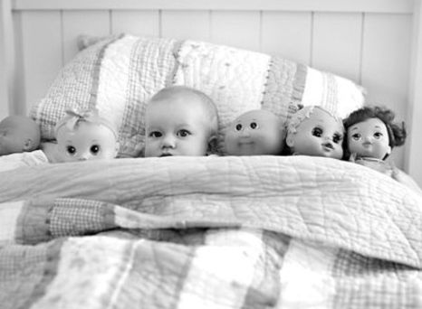 I have a similar pic of Michelle.  Great pose..baby in bed with all the dolls- would also work for stuffed animals