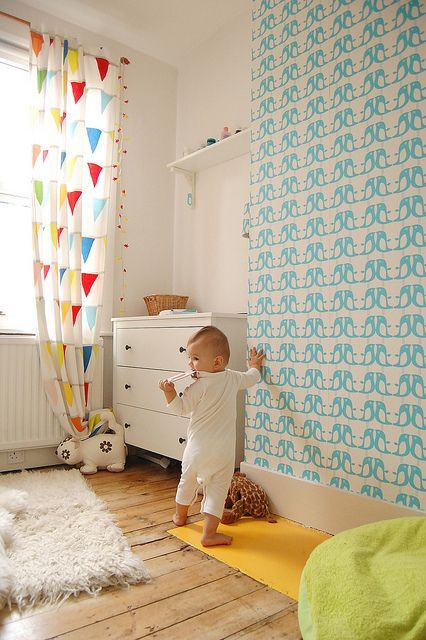 Love the wall paper and the feel of this babies room