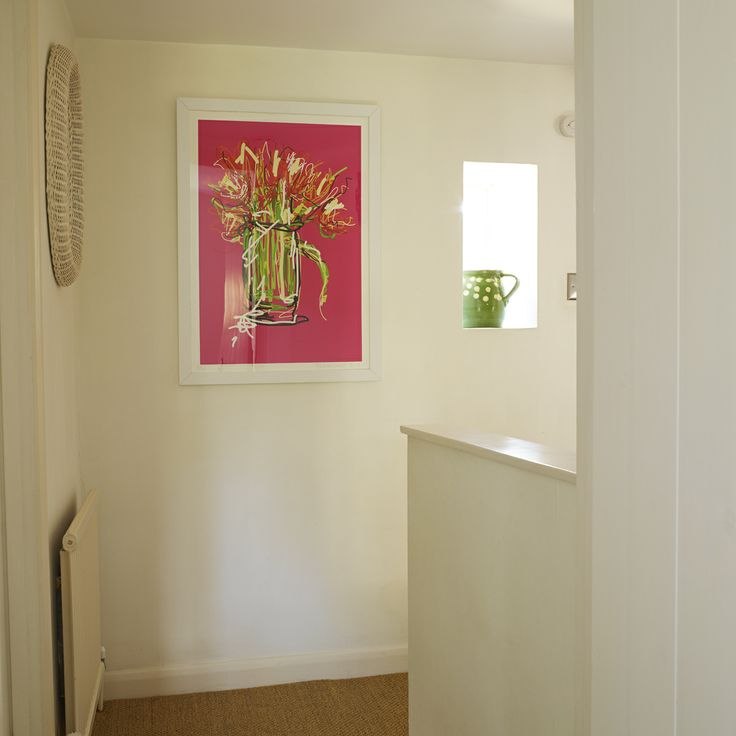 This photograph shows the landing at our cottage and Fenella Beauchamp's 'Tulips' iPad painting.