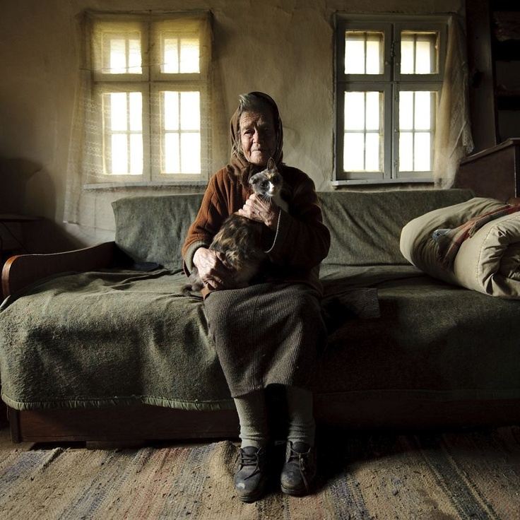"""Victoria and the cat""     Place: Sirnea, Brasov, Romania    photography Vlad Dumitrescu, Romania"