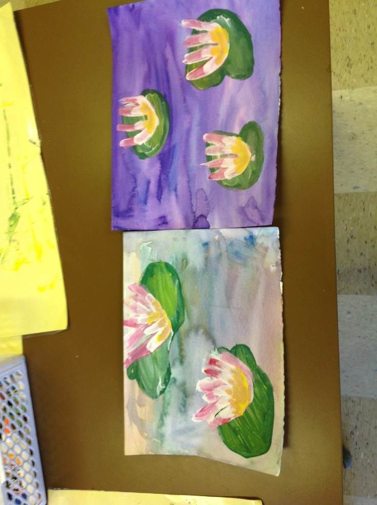 1st grade Monet Paintings.  Watercolor backgrounds on watercolor paper.  Tempera paint lily pads.