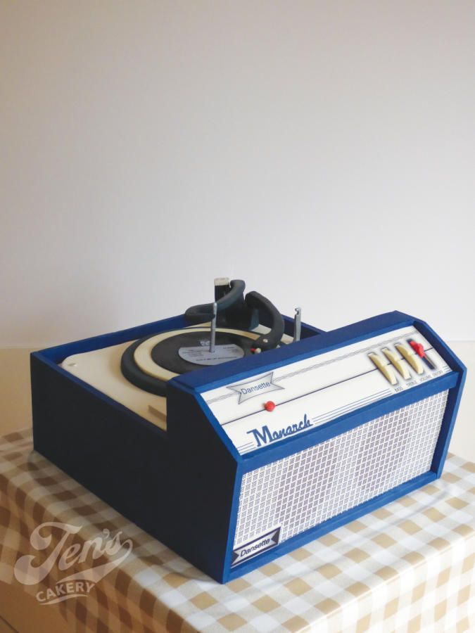 "A life-size CAKE replica of a Dansette record player. All of the details are as realistic as possible, right down to the leatherette finish and the grooves on the record (which is ""Build Me Up, Buttercup"" by the way :-) ~ Created by Jen's Cakery"