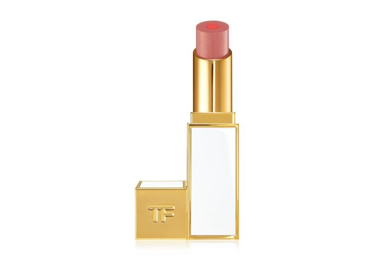 Two innovative formulas in one lip product. In the center, a liquid core infused with passion fruit oil provides luxurious moisture in a pink pop of color throughout every moisturecore lip color shade. A luminous lip color encases the core, infused with an exotic blend of melon fruit extract, murumuru butter and plant-derived esters that helps condition lips. Sprinkled with subtle golden pearl to complement bronzed summer skin.