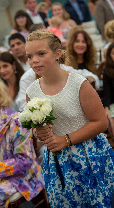 Cat Young, Cheryl Hines' daughter. Cheryl's 10-year-old daughter Catherine Rose Young carries a bouquet of cream roses.