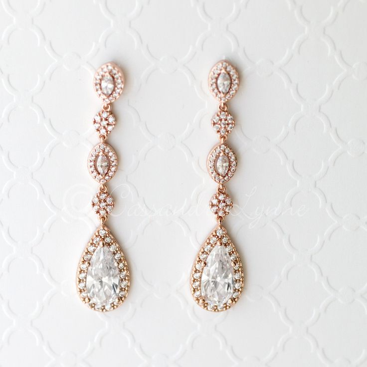 Rose gold wedding earrings with elongated teardrop or pear CZ jewels. Perfect for any special occasion!