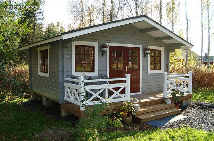 If you've got a big garden, how about a traditional style log cabin as a place to escape, work or play? This customer photo shows the GardenLife Deben log cabin painted in pale green, brown and white - it looks perfectly at home in the woods!