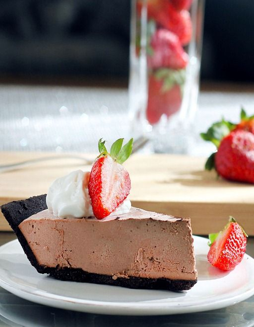 Melt-In-Your-Mouth Chocolate Truffle Pie - it tastes so sinfully rich but is secretly GOOD for you! (No sugar, no flour, and no baking required) http://chocolatecoveredkatie.com/2012/02/16/chocolate-strawberry-truffle-pie/