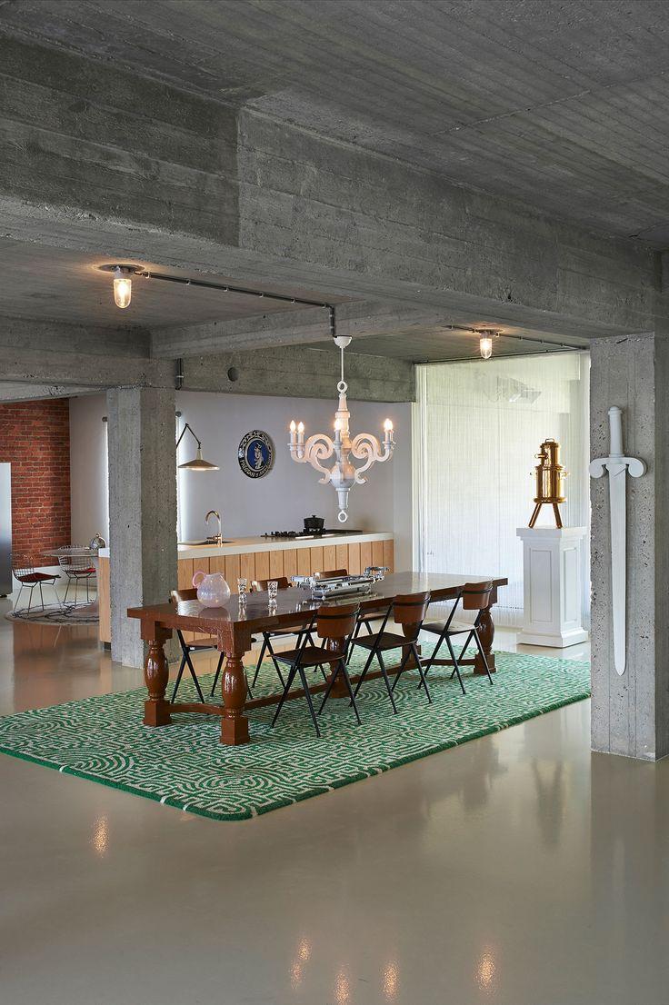 Dining room.Roundtable: Knoll Eero Saarinen, 1953. Wire chairs: Knoll, Harry Bertoia, 1950-1952Wall lamp: Panama, Gispen, Wim Rietveld, 1955. Ceramic plate: Aeroflot, Ravage, 1990. Chandelier: Paper Chandelier (special), Moooi, Studio Job, 2005. Bronze: Homework, Pinnochio, Studio Job, 2007. Porcelain sword: Sword, Studio Job, 2003. Table: paper dining Table, Studio Job, 2007. Chairs: Pyramid chairs, Ahrend, Wim Rietveld, 1960. Pink can: TE, Grand Bernard, Scholten & Baijings, 2009. Scal...
