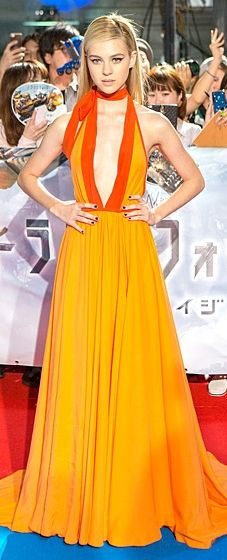 Nicola Peltz wore a tangerine halter gown with a plunging neckline by Prada to the Transformers: Age of Extinction Premiere in Tokyo.