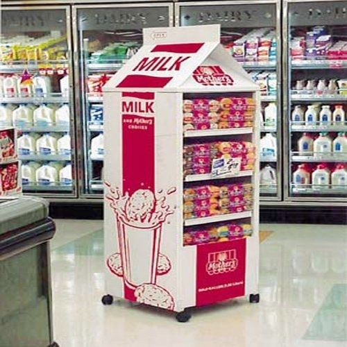 This point of display is very cool because the display resembles a milk carton. The products being sold is inside the milk carton are Cookies. The display is a milk carton because the cookies are supposed to be dipped in milk. The display is in the milk isle which is useful because shoppers who don't normally go in the milk isle will notice the cookies. It is also useful because the cookies in the milk isle are not under as much competition from the other cookie point of displays