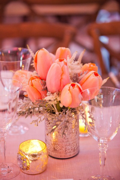 Tulip centerpiece.  LOVE.  Simple, small and with candles.  Like the vase too
