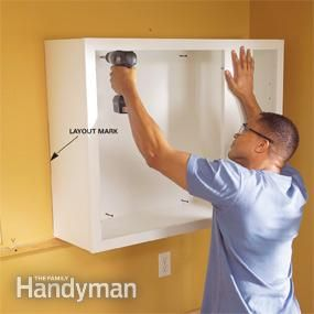 Install the upper cabinets