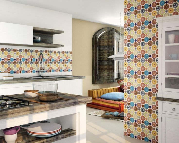 Dune Mandala  mosaic with circle and geometrical shapes with a blend of light blue, green, red, yellow colors