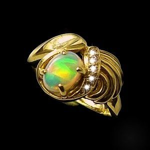 opal ring set in 18k yellow gold with additional diamonds