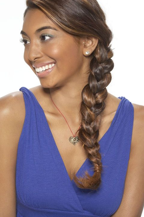 Part hair on the side, and begin braiding right below your ear, wrapping hair to the side as you go. Secure with hair band, and run a smoothing serum over hair to tame flyaways and add shine.