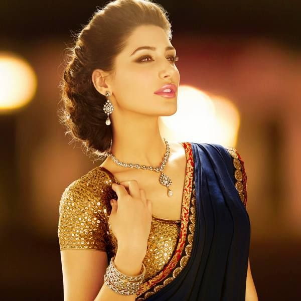 Nargis Fakhri wearing Blue Crape Saree