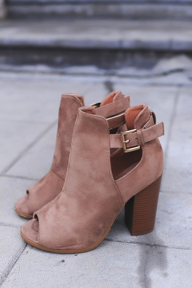 Suede open toe booties with open side buckles & chunky heels.  Even on warm days, these shoes are more comfortable and cooler than you would imagine.