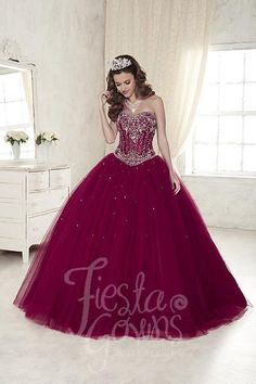 Quinceanera ball gown, strapless sweetheart neckline, heavy crystal beading with boning, very full organza wired edge ruffles, with sequins throughout skirl, and a lace-up back. Download the Fiesta Go