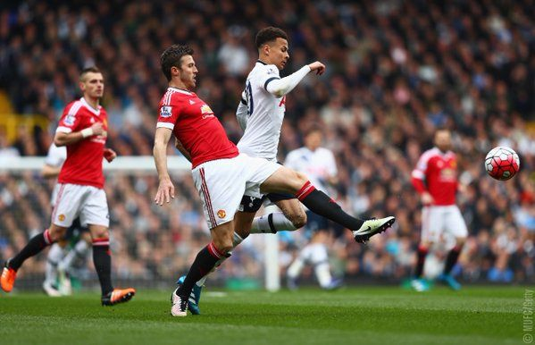 @Carras16 challenges Dele Alli in a fierce midfield battle. It's 0-0 with 20 minutes gone