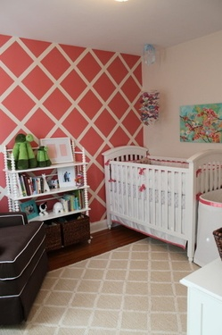 Not planning on having any kids any time soon (or ever) but I really love this coral and white wall in a girl's nursery.  I also adore that picture over the crib.