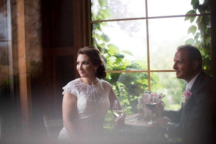 Vineland Estates bride and groom enjoying some wine