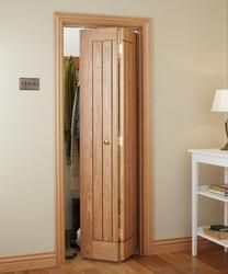 From Howdens: With its bold design, the Dordogne Oak Bi-Fold door adds a sense of heritage to traditional interiors.