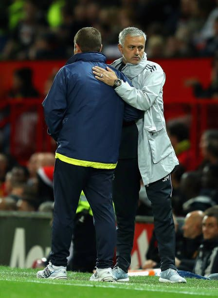 Nigel Clough manager of Burton Albion and Jose Mourinho Manager of Manchester United embrace after the Carabao Cup Third Round match between...