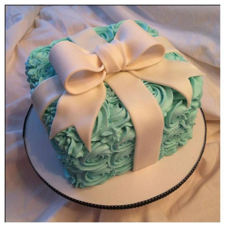 "Tiffany's Themed 1st Birthday - This cake was especially for the Birthday girl's smash cake photo session - Her celebration was ""Breakfast at Tiffany's"" themed. Vanilla cake with vanilla buttercream and a fondant bow."