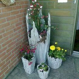 Take old cloth, soak in cement water, drape over a stand & leave in the sun to dry.  Paint & you have beautiful plant holders.  ;)