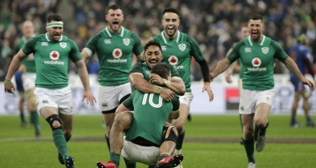 Ireland outhalf Jonathan Sexton feted by  Ireland centre Bundee Aki and colleagues after scoring a drop goal to beat France 15-13 in their Six Nations opener at the Stade de France in Paris. Photograph:  Thomas Samson/AFP/Getty Images