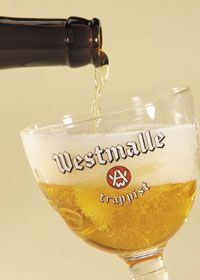 a glass of Westmalle Tripel being poured