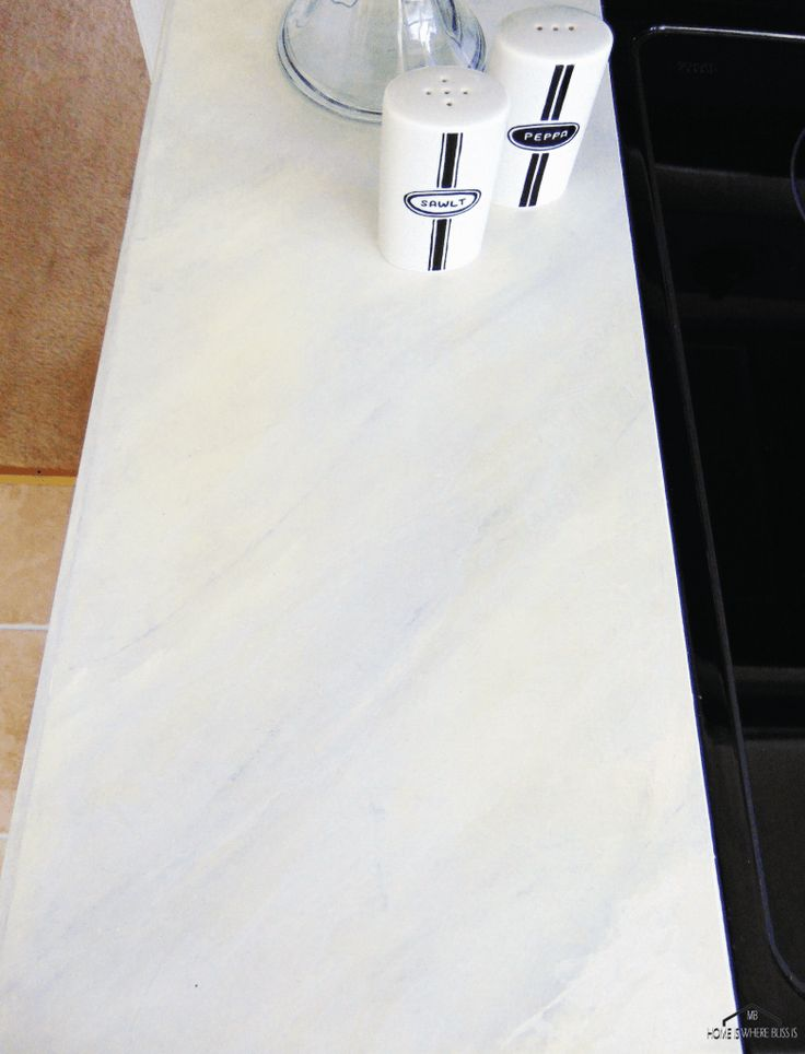 Painted Faux Carrara Marble Kitchen Counter DIY. Perfect for those dated linoleum countertops
