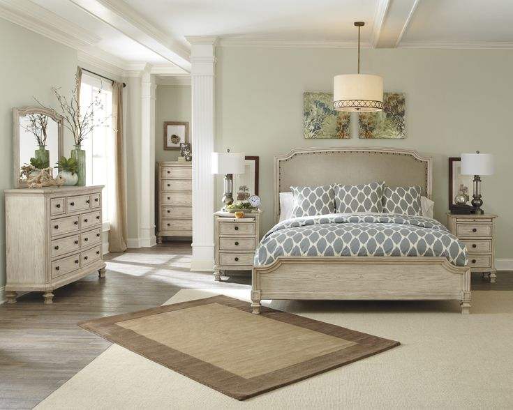 ashley u2013 demarlos the bedroom collection features large scaled headboard frames surrounding the nicely crowned textured upholstered cushion with
