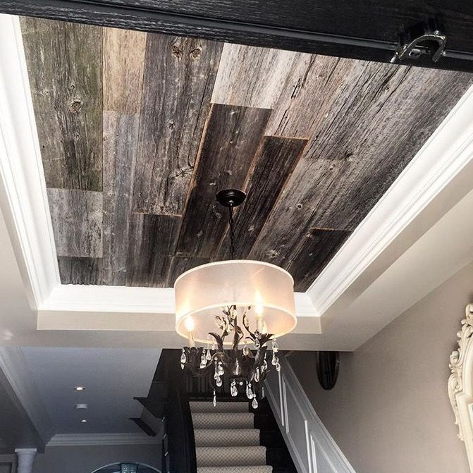 Grey barn board feature on this ceiling adds the perfect touch of rustic elegance.