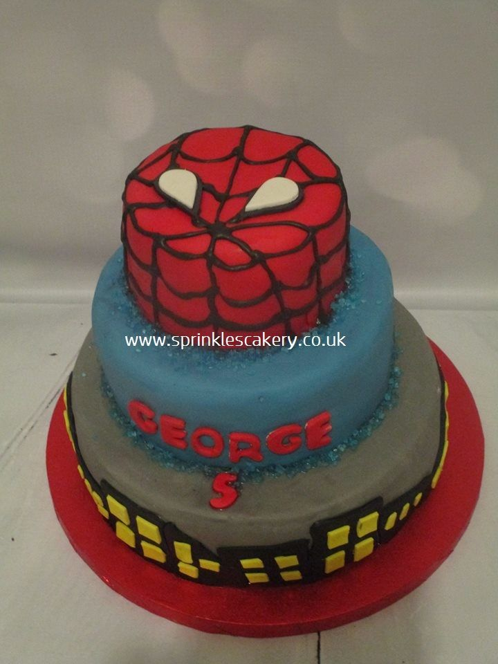 A simple shallow 3 tiered Spiderman cake for a huge superhero fan.