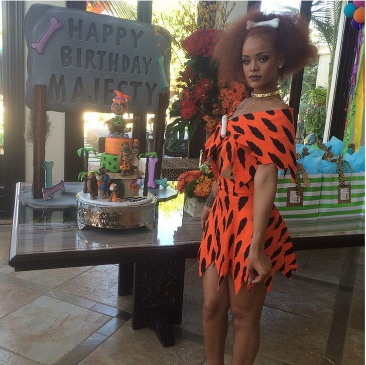 Behold the undeniable style power of Rihanna: She can even make a *Pebbles Flinstone* costume look chic. At a birthday party for her cousin's daughter Majesty, RiRi puts allllll our Halloween ensembles to shame.   - MarieClaire.com