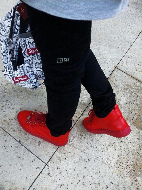 e98e885cac2e All red Balenciaga Arena  sneakers and Supreme backpack.  fashion ...