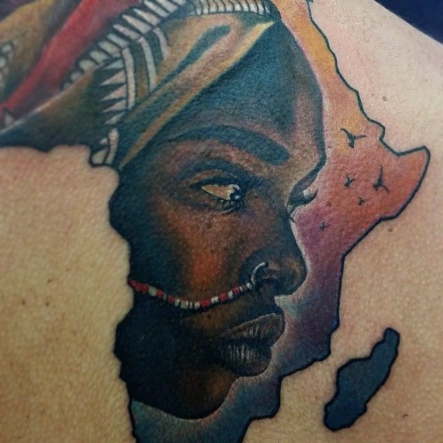 The shape of the Africa continent is perfect to include another design, often the face of a beautiful African woman. Here by Miguel Angel Espinosa.