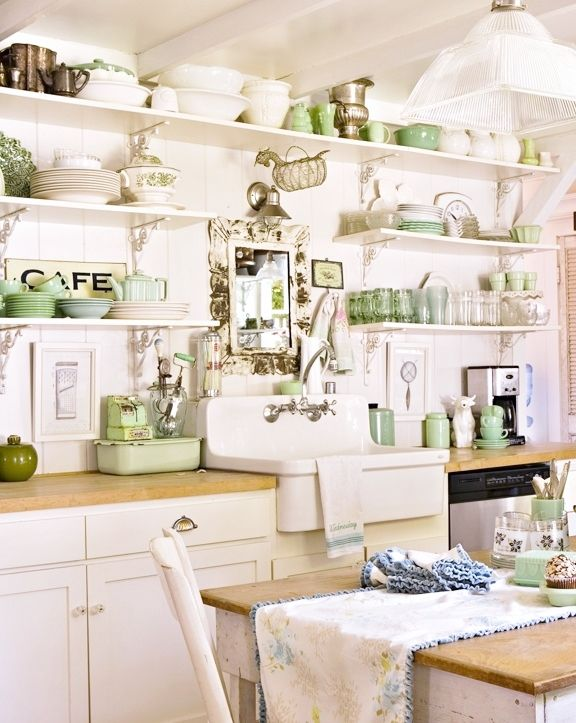 Green and white on open kitchen shelves